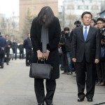 Cho Hyun-ah, daughter of chairman of Korean Air Lines, bows in front of the media outside the offices of the Aviation and Railway Accident Investigation Board in Seoul