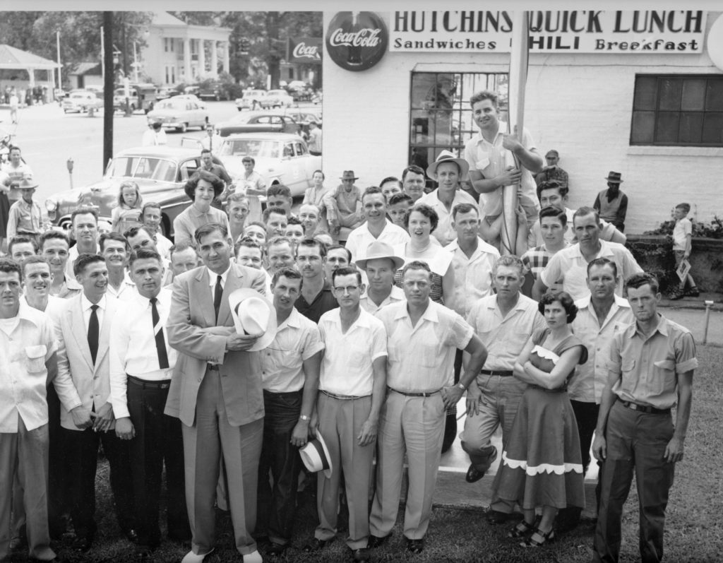 "1954 - Big Jim Folsom in front of Hutchins Quick Lunch, located on Greensboro Ave. Several people are BFGoodrich workers. Identified in the photo are: Hoyt Hamner, Cliff Mock, Ace Trammel, Billy Thomson, Fuller Kimbrell, Fred Tune, Wallace Hartley, Leon Lunceford, Mary Hartley, Gray Hall, Edgar L. Strickland, ""Radio"" Heath, ? Crawford, Morris Burns, J.O. Elliott, S.O. Morrison, Julian Hoots, Linda burt Shirley, Clarence A. Burt, Hazel Smallwood, Aaron Waldrop, Von Johnson, Imogene Hartley, Willie williamson, William L. Smith, James Lancaster, Laudon Jones and Walter Etheridge. - submitted by Jimmy Glover"